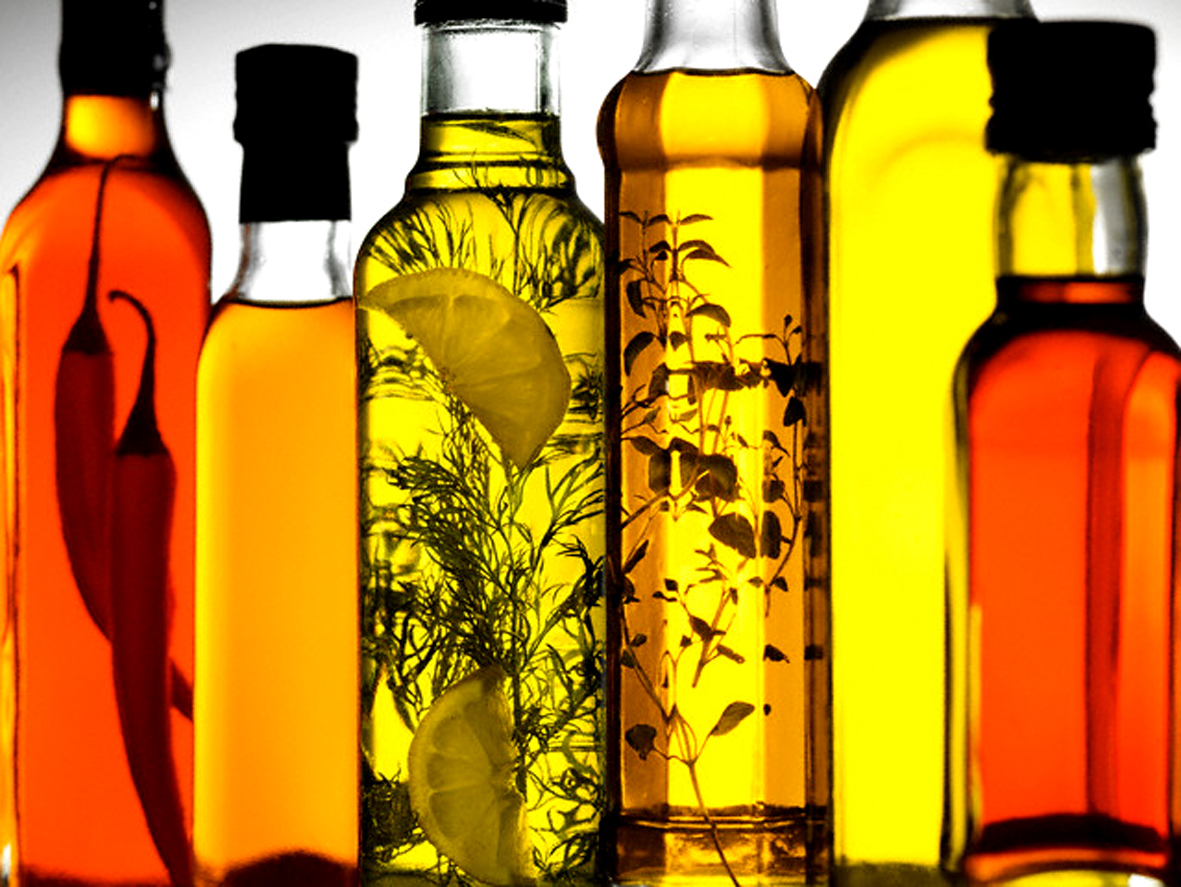 Herb-infused Oils --- Image by © Steve Lupton/Corbis